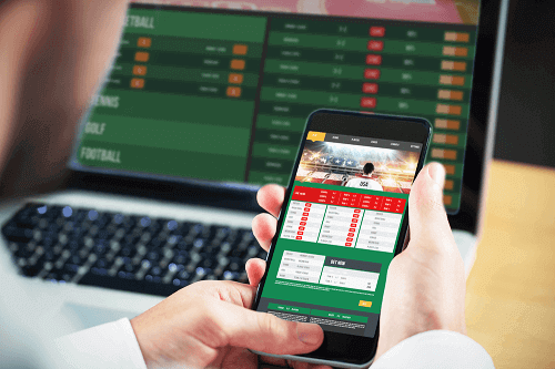 non-casino sports betting on mobile device and laptop